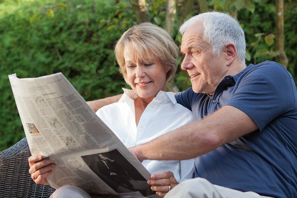 Elderly Couple reading the newspapers