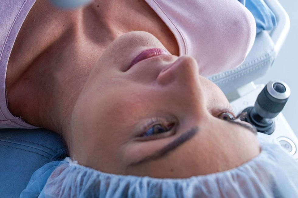 Woman on surgical bed for LASIK