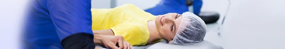 Doctor assists patient before LASIK