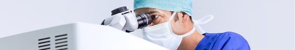 Doctor using the laser during laser eye surgery